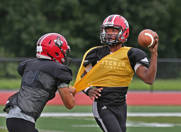 MIKE SPRINGER/Staff photo<br /> Quarterback Wayne Holloway tries to get a pass away under defensive pressure from teammate Noel Galioto during a varsity football scrimmage Saturday at Bertram Field in Salem.<br /> 8/25/2018
