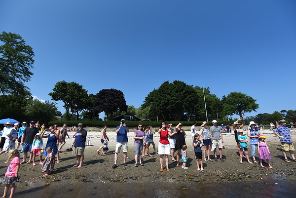 PAUL BILODEAU/Staff photo. A crowd of people watch from the shore during the annual Beverly Home Coming Cardboard Boat Race at Lynch Park in Beverly.  8/5/18
