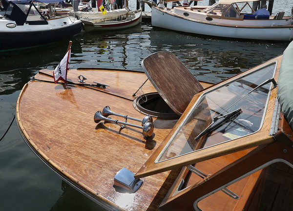 MIKE SPRINGER/Staff photo<br /> The Orb, a 1970 Lyman Boat Works runabout owned by David Williams of Salem, is on display with other boats during the annual Antique and Classic Boat Festival on Saturday in Salem.<br /> 8/25/18