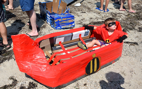 PAUL BILODEAU/Staff photo. Wiley Paddol, 3, dressed as one of The Incredibles sits in his cardboard boat before the start of the annual Beverly Home Coming Cardboard Boat Race at Lynch Park in Beverly.  8/5/18