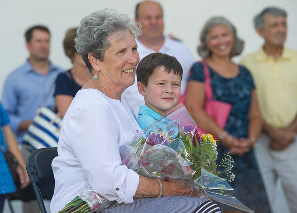 AMANDA SABGA/Staff photo<br /> <br /> JoAnn Sampson sits with her grandson Griffin Moore, 5, as she is awarded Senior of the Year at Senior Day in the park at Lynch Park as part of Beverly Homecoming.<br /> <br /> 8/2/18