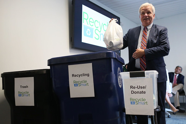 HADLEY GREEN/Staff photo<br /> Department of Environmental Protection Commissioner Martin Suuberg gives a recycling demonstration at the Salem City Hall Annex. Lt. Gov. Karyn Polito joined Suuberg and Salem Mayor Kim Driscoll to announce grant money for recycling programs in Salem and other North Shore communities.<br /> <br /> 08/20/2018