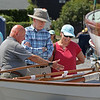 MIKE SPRINGER/Staff photo<br /> Etta and Stanley Shapiro of North Andover listen as Duncan Maitland of the Swampscott Historical Society explains the features of a historic dory during the annual Antique and Classic Boat Festival on Saturday in Salem.<br /> 8/25/18
