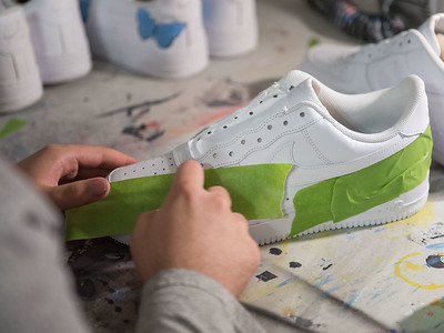 AMANDA SABGA/Staff photo  Recent high school graduate Vinnie Ducharme, 18, of Groveland tapes the outline of a sneaker design at his workstation. Ducharme is building his name and brand by custom designing sneakers as Late Night Custom.    8/13/19