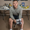 AMANDA SABGA/Staff photo<br /> <br /> Recent high school graduate Vinnie Ducharme, 18, of Groveland poses for a photo in his at-home studio. Ducharme is building his name and brand by custom designing sneakers as Late Night Custom. <br /> <br /> 8/13/19