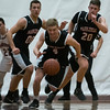 SAM GORESH/Staff photo. Marblehead senior Patrick Bugler chases a loose ball in their game against Gloucester at Gloucester High School. 12/16/16