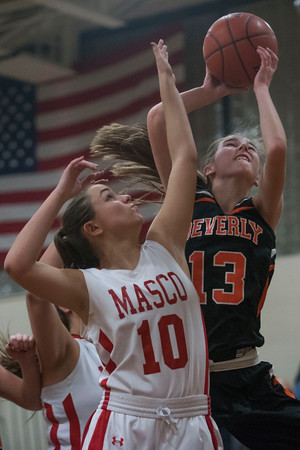 SAM GORESH/Staff photo. Beverly junior Rosie Gotsch goes up for a basket as Masconomet senior Mary Erb attempts to stop her on defense in the Masconomet Girls Basketball Holiday Invitational. 12/27/16