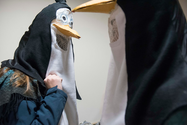 SAM GORESH/Staff photo. Lana Meager, 15, (left) and Catherine Johnson, 15,  (right) don penguin masks for the Grand Procession parade during Beverly's New Year's celebration on Cabot Street. 12/30/16