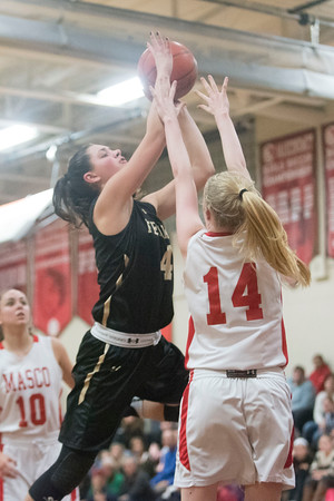 SAM GORESH/Staff photo. Bishop Fenwick sophomore Olivia DiPetro shoots the ball as Masconomet sophomore Marissa DeLucia attempts to stop her on defense in the final game of the Masconomet Girls Basketball Holiday Invitational. 12/29/16