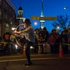 Peter Cannizzaro performs with a fire hoop for the crowd at Beverly's New Year celebration on Cabot Street. 12/30/16