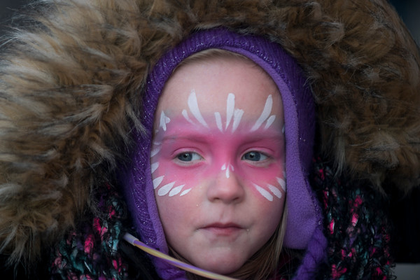 Audrey Corey, 5, keeps warm with layers during Beverly's New Year's  celebration on Cabot Street. 12/30/16