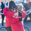 SAM GORESH/Staff photo. Eric Barrett hugs her daughter Madi Barrett, 9, after they finished running the Law Enforcement Torch Run at Analogic benefitting the Special Olympics. Made Barett's goal was to finish the race before her mother, which she accomplished. 12/4/16