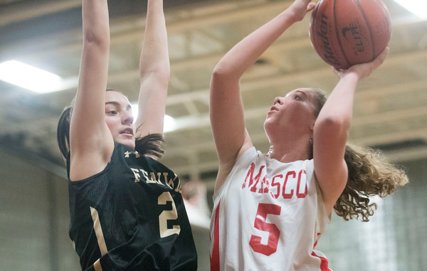 SAM GORESH/Staff photo. Masconomet junior Paige Amyouny goes up for a basket as Bishop Fenwick sophomore Jaxon Nadeau attempts to stop her on defense in the final game of the Masconomet Girls Basketball Holiday Invitational. 12/29/16
