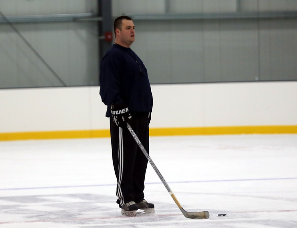 DAVID LE/Staff photo. Essex Tech boys hockey head coach Mike Geary instructs his players at practice. 12/8/16.