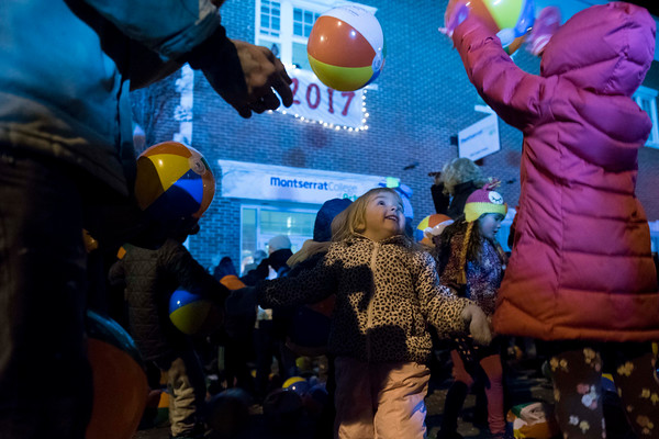 Norah Hook, 3, plays in the beach balls during Beverly's New Year's celebration on Cabot Street. 12/30/16