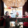 SAM GORESH/Staff photo. Valerie Peterson (let) and Eileen D'Amour play flutes as part of the Harbor Flutes flute and cello ensemble in the dining room of the Joseph M. Parsons House during the Christmas in Salem House Tour. 12/4/16