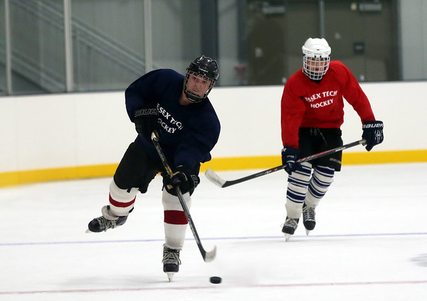 DAVID LE/Staff photo. Essex Tech boys hockey players work on line changing drills at practice. 12/8/16.