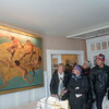 SAM GORESH/Staff photo. Visitors to the Edwin H. Dodge House admire the artwork on the wall by homeowner artist Thomas Darsney during the Christmas in Salem House Tour. 12/4/16