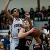 SAM GORESH/Staff photo.Marblehead senior Robert Millet goes up for a basket as Gloucester junior Brandon Rivera attempts to stop him on defense in their game at at Gloucester High School. 12/16/16