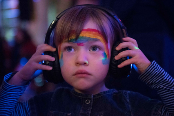 SAM GORESH/Staff photo. Adeline Vietzke, 4, listens to music on her headphones during the silent disco at the Salem Main Streets' Launch New Year's Eve event for families at the Old Town Hall. 12/31/16