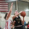 SAM GORESH/Staff photo.Bishop Fenwick junior Jennie Meager prepares to shoot the ball as Masconomet senior Mary Erb attempts to stop her on defense in the final game of the Masconomet Girls Basketball Holiday Invitational. 12/29/16
