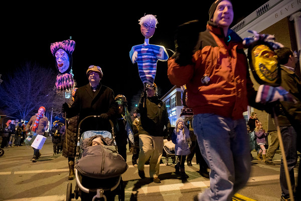 SAM GORESH/Staff photo. The Grand Procession parade makes its way down Cabot Street during Beverly's New Year's celebration. 12/30/16