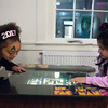 SAM GORESH/Staff photo. Sydney Honor, 6, (left) and Eva Gonzales, 5, (right) play Ms. Pac-Man at Salem Main Streets' Launch New Year's Eve event for families at the Old Town Hall. 12/31/16