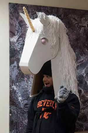 Jay Filtrate wears a unicorn costume for the Grand Procession parade during Beverly's New Year's celebration on Cabot Street. 12/30/16