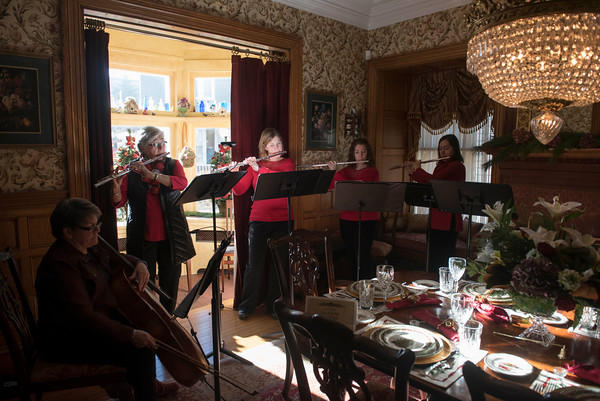 SAM GORESH/Staff photo. Members of the Harbor Flutes flute and cello ensemble play in the dining room of the Joseph M. Parsons House during the Christmas in Salem House Tour. 12/4/16