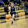 HADLEY GREEN/Staff photo<br /> Pingree's Savannah Gibbs (12) moves the ball at the Pingree v. Dana Hall girls basketball game at the Pingree School.