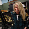 HADLEY GREEN/Staff photo<br /> Chrissy Lebel works on a custom sign in her studio at Lebel Signs in Lynn.<br /> <br /> 12/23/17