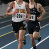 MIKE SPRINGER/Staff photo<br /> Bishop Fenwick's Aiden Hill leads Shawn Brown of Arlington Catholic in the 1000-meter run during a Tri-County Track & Field League meet Tuesday at the Reggie Lewis Track and Field Center in Roxbury Crossing.<br /> 12/26/2017