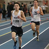 MIKE SPRINGER/Staff photo<br /> Steven Jackson, left, and Ted Moskal of St. John's Prep compete in the one-mile run during a Tri-County Track & Field League meet Tuesday at the Reggie Lewis Track and Field Center in Roxbury Crossing.<br /> 12/26/2017