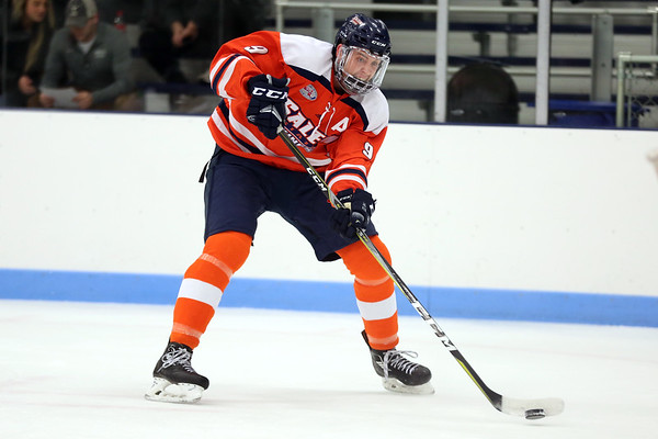 HADLEY GREEN/Staff photo<br /> Salem State's Daniel Campbell (9) flies towards the net at the Endicott v. Salem State boys hockey game at Endicott College.