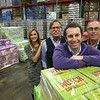 Ken Yuszkus/Staff photo   From left, Jennifer, Jack, Mark, and Richard Tatelman in the Merrimack Valley Distributors warehouse.       12/7/17