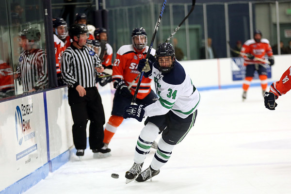 HADLEY GREEN/Staff photo<br /> Endicott's Michael Heidkamp (34) moves the puck at the Endicott v. Salem State boys hockey game at Endicott College.
