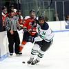 HADLEY GREEN/Staff photo<br /> Endicott's Michael Heidkamp (34) moves the puck at the Endicott v. Salem State boys hockey game at Endicott College.