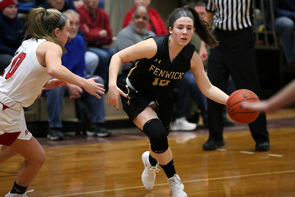 HADLEY GREEN/Staff photo<br /> Bishop Fenwick's Courtney Norton (10) moves the ball at the Masconomet v. Bishop Fenwick girls basketball game at Masconomet High School.<br /> <br /> 12/23/17