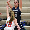 HADLEY GREEN/Staff photo<br /> Hamilton-Wenham's Jacqueline Fibbe (5) looks for a pass at the Masconomet v. Hamilton-Wenham girls basketball game at Masconomet High School.