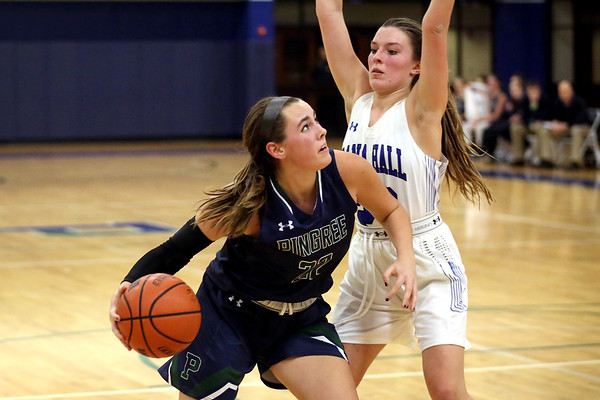 HADLEY GREEN/Staff photo<br /> Pingree's Allison Falvey (22) dribbles to the basket while Dana Hall's Natalia Gonyea (22) plays defense at the Pingree v. Dana Hall girls basketball game at the Pingree School.