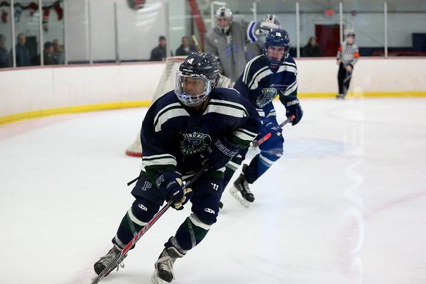 HADLEY GREEN/Staff photo Pingree's Amogh Prakash (8) skates to the puck at the Pingree v. Berwick Academy boys hockey game at the Pingree School.