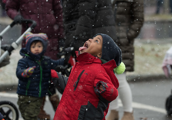 AMANDA SABGA/Staff photo. <br /> <br /> Jerry Fraizer, 4, of Beverly, stick his tongue out to catch snowflakes at the annual Santa by the Sea event at Pope's Landing in Danvers.<br /> <br /> 12/9/17