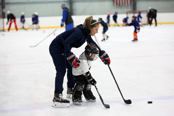 HADLEY GREEN/Staff photo<br /> Meghan Duggan of Danvers will again be on the women's hockey team in the 2018 Winter Olympics. Duggan held a fundraiser at Essex Sports Center in Middleton so her family can make the trip to South Korea to watch her play. <br /> <br /> 12/23/17