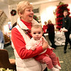 HADLEY GREEN/Staff photo<br /> Karen Sorbera holds her granddaughter, Hailey, at the 24th annual holiday party for Salem Children's Charity at the Hawthorne Hotel.
