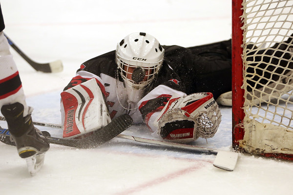 HADLEY GREEN/Staff photo<br /> Marblehead's goalie Peter Santeusanio (31) makes a save at the Marblehead v. Danvers boys hockey game at the Rockett Arena. <br /> <br /> 12/23/17