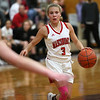 HADLEY GREEN/Staff photo<br /> Masconomet's Mak Graves (3) dribbles towards the basket at the Masconomet v. Bishop Fenwick girls basketball game at Masconomet High School.<br /> <br /> 12/23/17