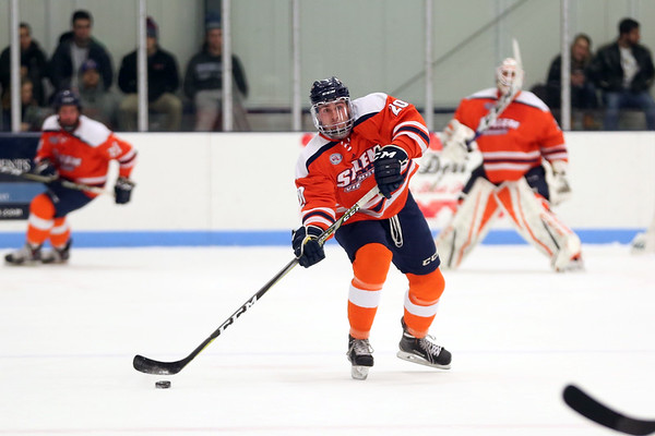 HADLEY GREEN/Staff photo<br /> Salem State's Parker Wood (20) passes to a teammate at the Endicott v. Salem State boys hockey game at Endicott College.
