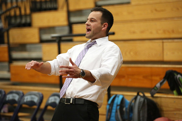 HADLEY GREEN/Staff photo<br /> Ipswich girls basketball coach Chris Tolios reacts to a play during the Hamilton-Wenham v. Ipswich game at Triton High School.<br /> <br /> 12/27/17