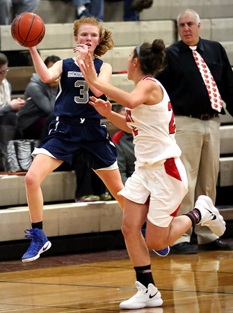 HADLEY GREEN/Staff photo<br /> Hamilton-Wenham's J Shea (3) moves the ball at the Masconomet v. Hamilton-Wenham girls basketball game at Masconomet High School.