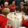 HADLEY GREEN/Staff photo<br /> People eat dinner at the 24th annual holiday party for Salem Children's Charity at the Hawthorne Hotel.
